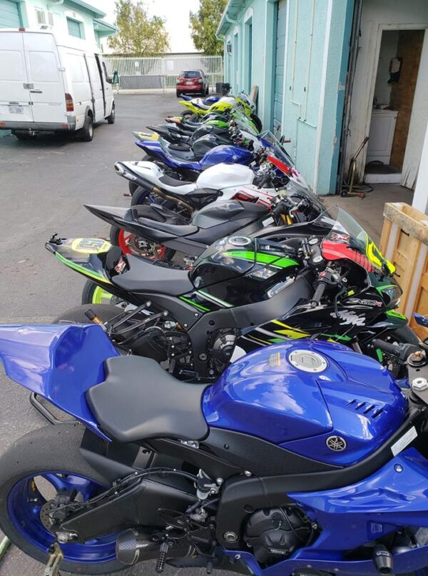 Motorcycles being prepared for transport or storage at Track Bike Rentals